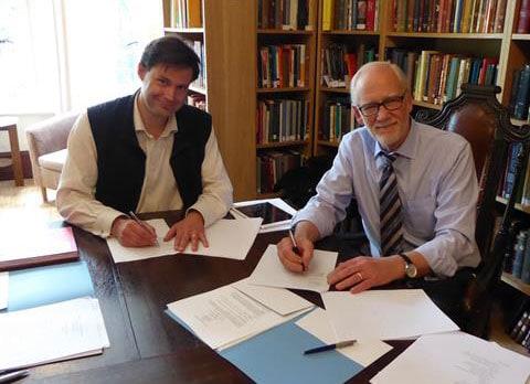 Licence signing between Crossway with Cambridge University Pres